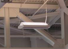 A durable industrial fluorescent lighting fixture for warehouses and ...